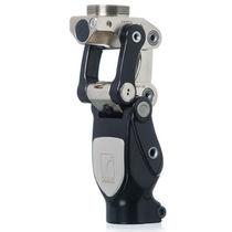 Prothèse externe de genou polycentrique / à contrôle de phase d'appui / à verrou manuel / 2