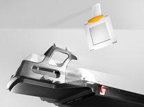 Accélérateur linéaire de particules radiochirurgie stéréotaxique / avec table de positionnement robotisée