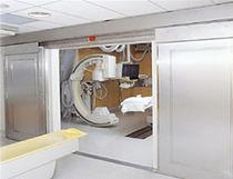 Porte pour IRM / coulissante / à enroulement / de radioprotection