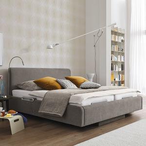 lit de soins à domicile