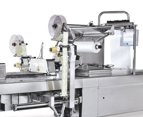 machine d'étiquetage pour thermoformeurs