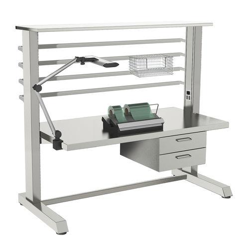 table de travail / de conditionnement d'instruments médicaux / rectangulaire / sur roulettes